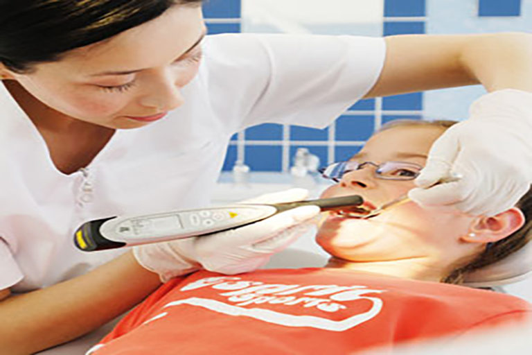 A dentist detects a cavity on a patient